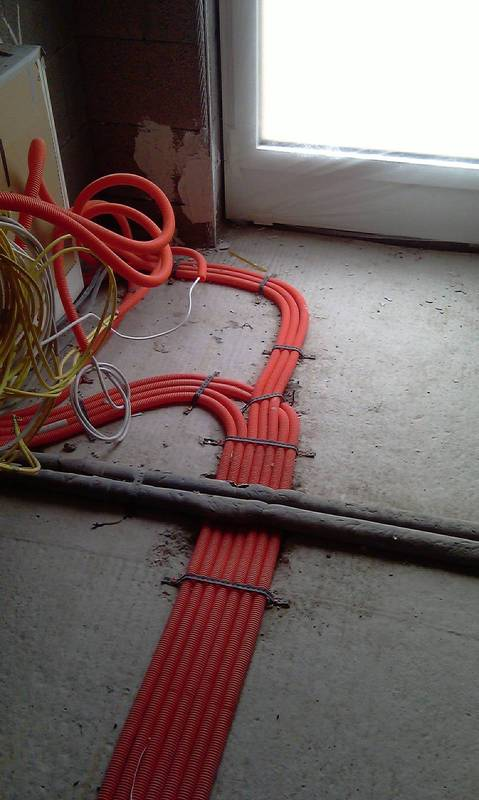 Empty pipes to be laid across the concrete floor.